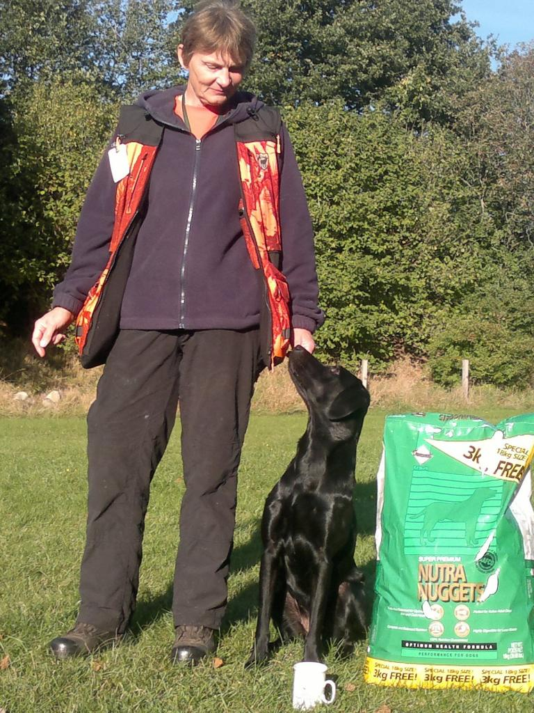 Helle Voigt with Ravensbank Mint (Minte) at unofficial cold game test in September 2013, and for the second time in only one week she becomes the best dog of the day in novice class! ©Helle Voigt