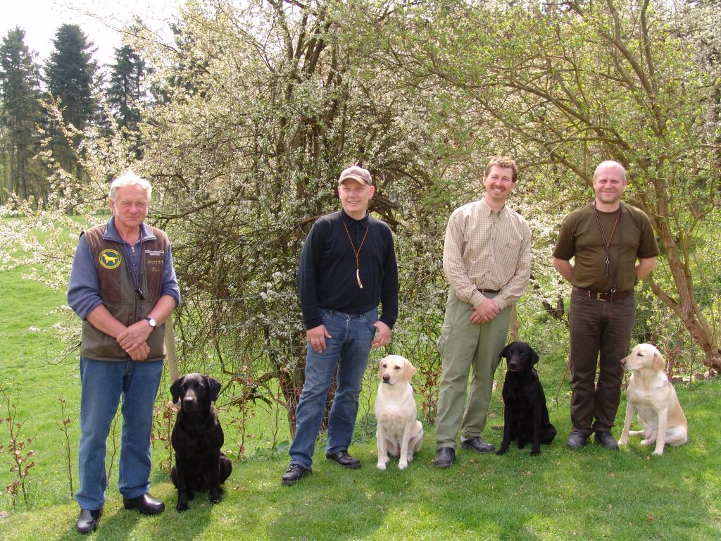 This is the team representing South Sealand Chapter of the Danish Retriever Club at the Team Championship event 2009. From left to right: 1. Gert Müller with DKBRCH DKJCH NOJCH SEJCH NORDJCH 2EV2010 3UM2008 Ravensbank Swift (Swiffer) (DKBRCH DKJCH Cynhinfa Emperor, Tidemark Ivy) bred by Søren Voigt. 2. Søren Voigt with Tidemark Ivy (Ivy) (GBFTCH Dargdaffin Dynamo, Springtide Beauty) bred by A.E. and E.A. Markham. 3. Karsten Hansen with Tidemark Archer (GBFTCH Dargdaffin Dynamo, Wellandpoint Princess) bred by A.E. and E.A. Markham. To the right 4. Palle Ingemann with DKJCH DKKJ06 DKDKKJCH DKBRCH Wetland's Wonder (GBFTCH Dargdaffin Dyanamo, Wellandpoint Princess) bred by A.E. and E.A. Markham. Team Captain Preben Hansen is not in the picture.©Ravensbank Labrador Retrievers
