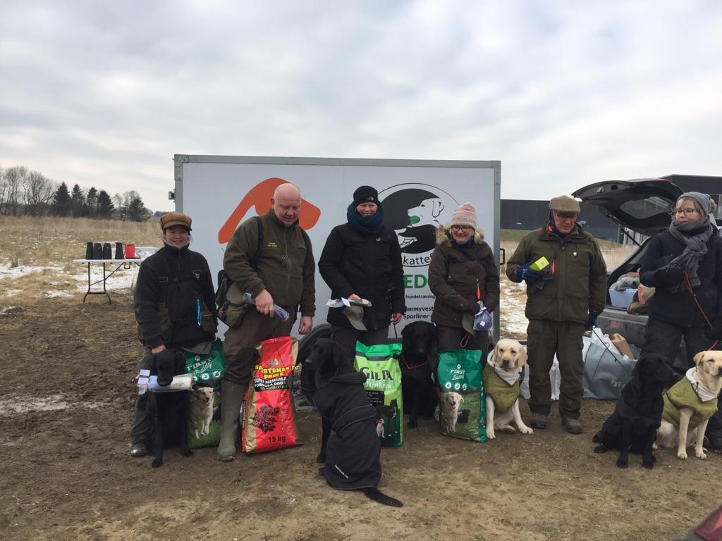 Here I am no. 2 from left to mark that I became 2nd winner in novice class at unofficial WT with Ravensbank Holly (Holly). The young dog isn't used to the spotlight, and has placed herself facing her back to the camera. ©Rene Kristensen