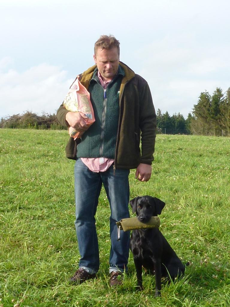 "Our very good friend, Mr. Bernd Albrecht and his lovely young Labrador Retriever Bitch, Bayard Von Den Hochangern aka ""Brizzer"" receives a 1. Prize and becomes the best dog on the day in novice class at the cold game test here at Fuenen in August 2012. ©Ravensbank Labrador Retrievers"